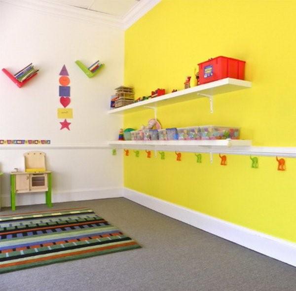 kindergarten interior yellow wall with shelves