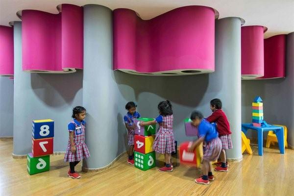 kindergarten interiors rosy accents blue wall