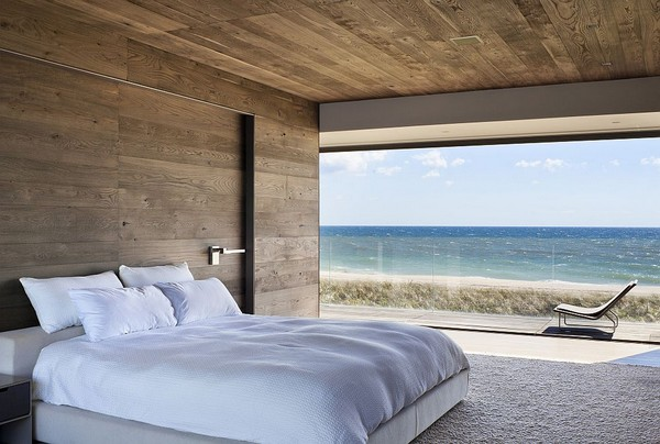 1-bedroom-interior-design-with-ocean-sea-view-panoramic-windows-bed-wooden-walls-ceiling