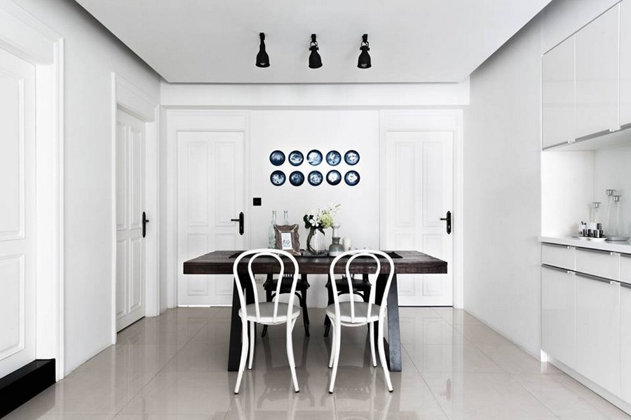 2-0-eclectic-Scandinavian-and-French-style-interior-white-walls-dining-room-set-dark-brown-table-mismatched-chairs-blue-decoartive-wall-plates-Copenhagen-minimalist-kitchen-set