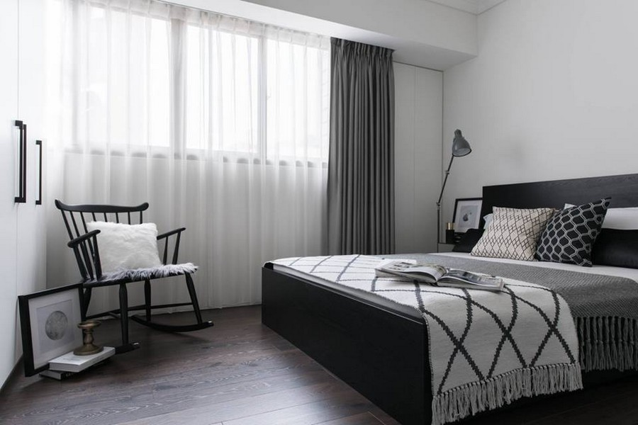 3-1-eclectic-Scandinavian-and-French-style-interior-bedroom-black-white-gray-wooden-bed-geometrical-home-textile-throw-pillows-bed-cover-bedspread-rocking-chair-curtains-floor-lamp-closet