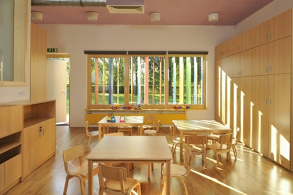 kindergarten interior beige chairs and tables