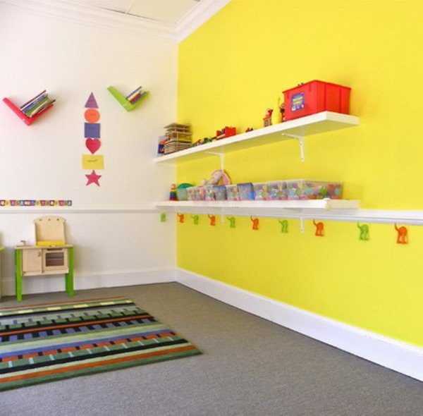 kindergarten interior yellow wall with shelves