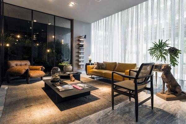 Marble floor at home living room elegant luxury black dark brown couch dog sculpture