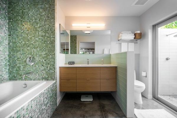 Mosaic tiles green headboard behind bed bedroom