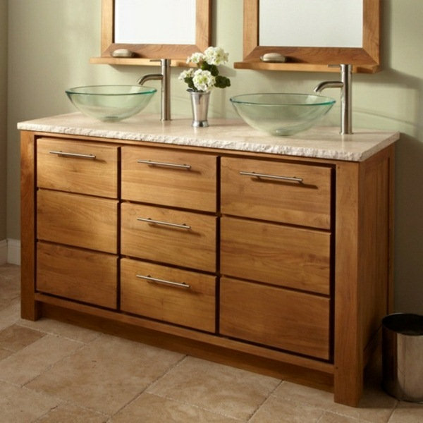 Glass washbasin with two sinks under cabinet