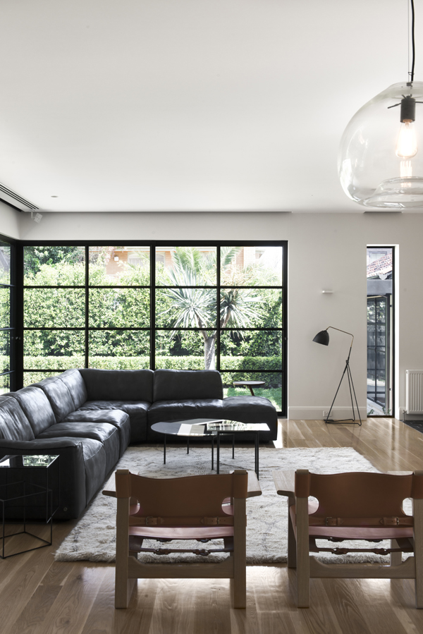 modern living room with industrial black steel-framed windows