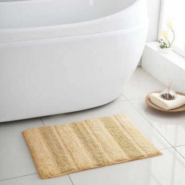 cotton bathmat little yellow model bathtub next to the