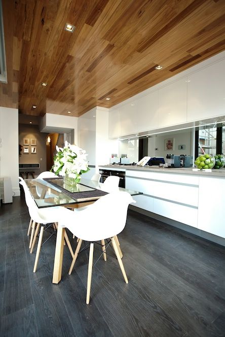 polished wooden ceiling with lights