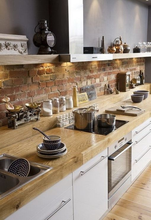 Kitchen: love the raised counter in back along with the brick. Modern yet rustic:
