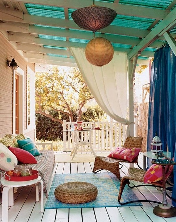 covered wooden porch rocking chairs façade flowers