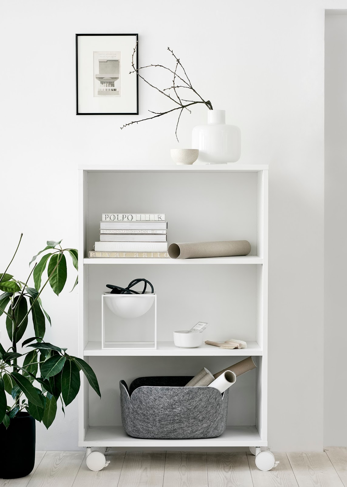 White shelf with wheels from Finnish Design Shop 24:7 collection. Styling and photos Riikka Kantikoski