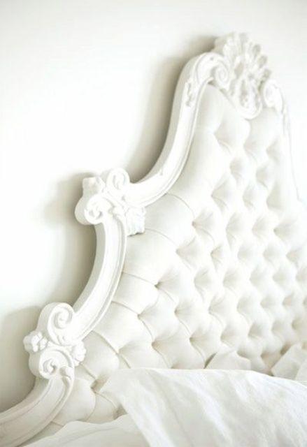 white curvy framed tufted headboard