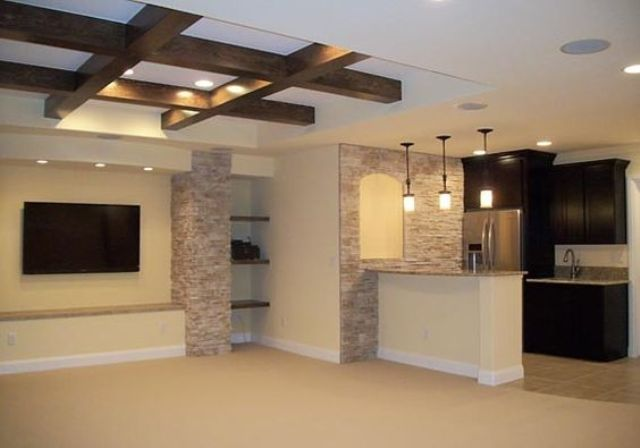 white basement ceiling with exposed beams