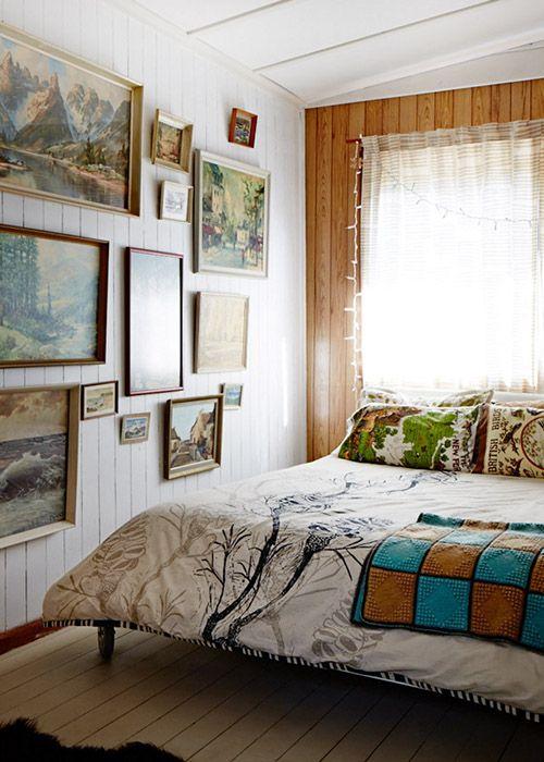 vintage gallery wall in a bedroom