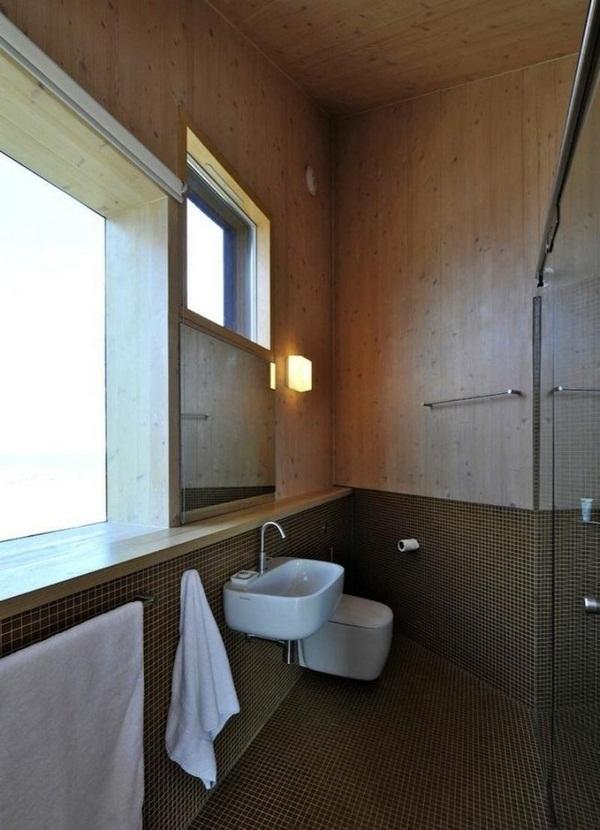panoramic windows asymmetrically house bathroom mosaic tiles brownwood glass washbasin wall loo