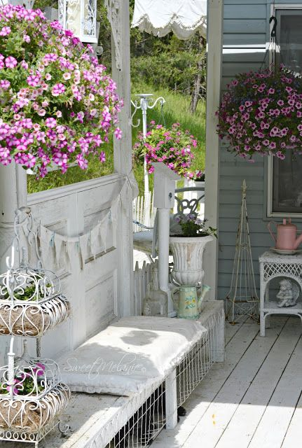 all white shabby chic terrace with lots of flowers
