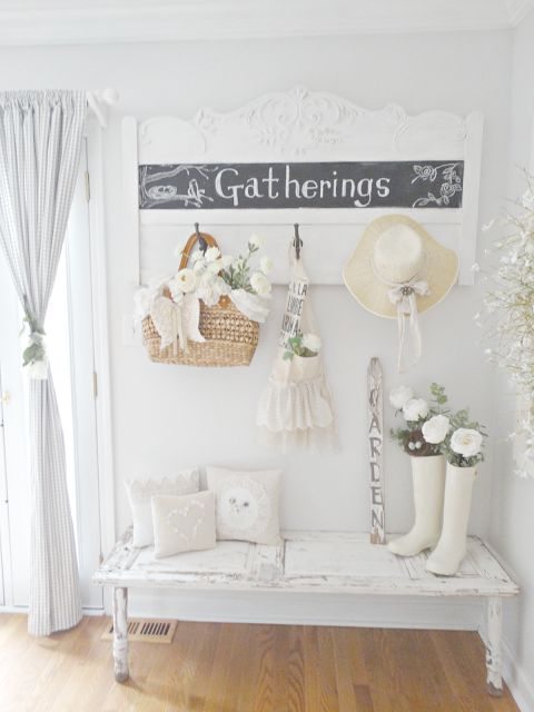 shabby chic whitewashed entryway with netural textiles and a chalkboard