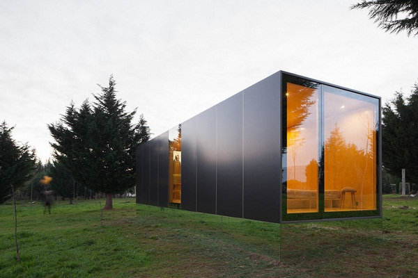 prefab house with lots of glass