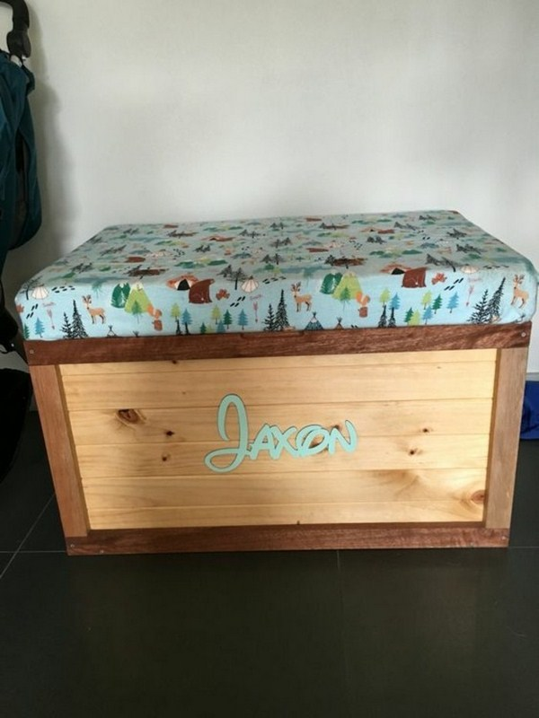 Toy boxes with various animals and trees