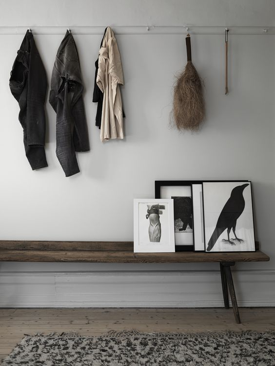 Simple entry with long wooden bench