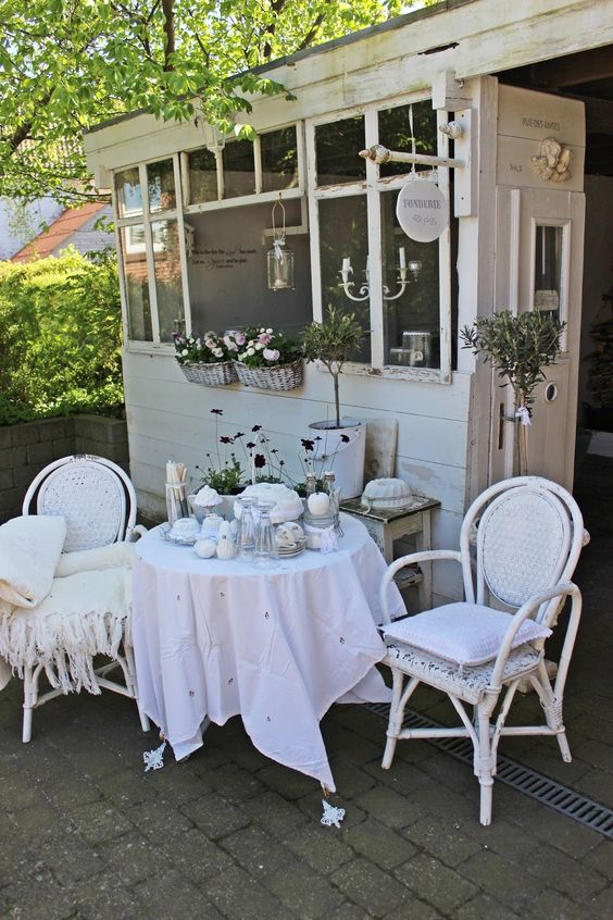 all white shabby chic terrace with touches of rustic style