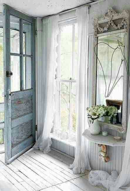 French style shabby chic entry with a serenity door