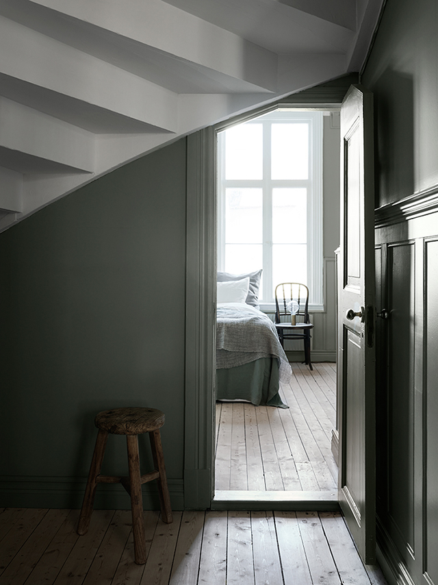 View to bedroom, earthy muted green wall