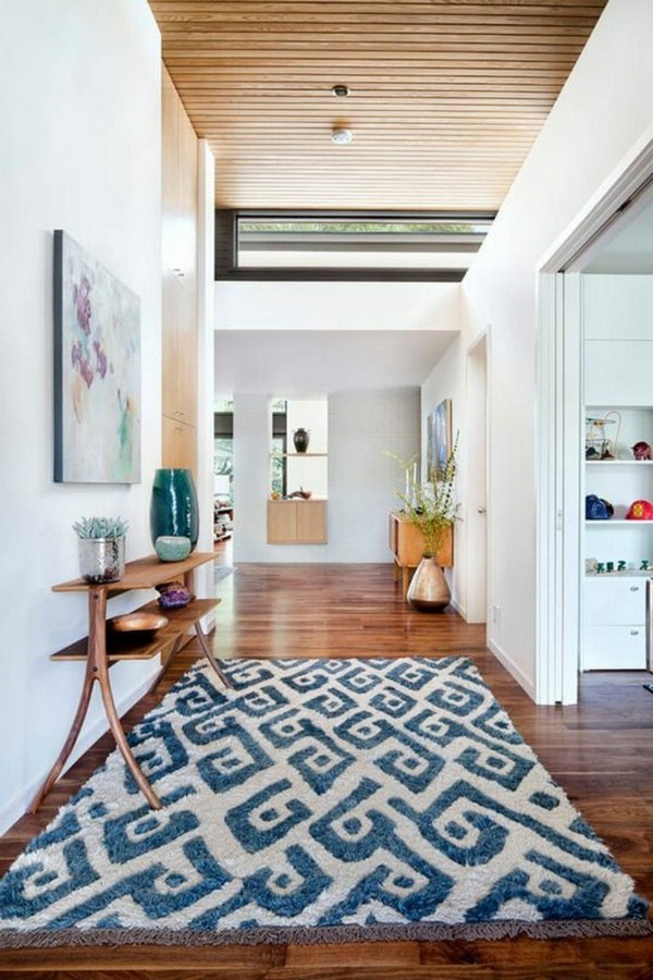Carpet in the hallway soft blue white rural design