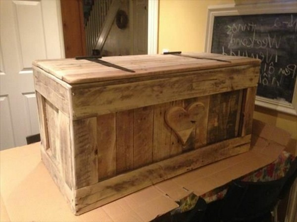 Chest children in wood with heart as decoration