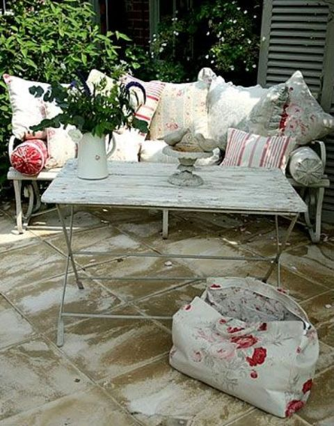 shabby whitewashed terrace table