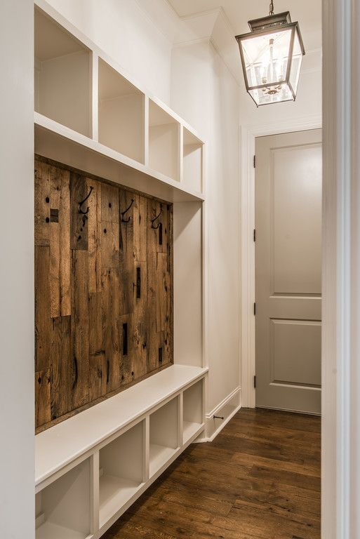 built in mudroom compartments and bench
