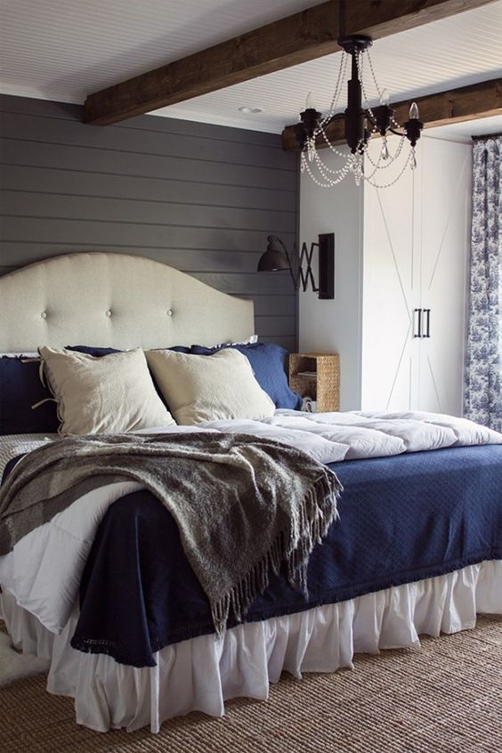 Add a hint of rustic, farmhouse authenticity to a bedroom with gray painted shiplap walls, a white ceiling and exposed wooden beams | Jenna Sue Designs: