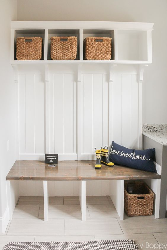 buuilt in mudroom bench with storage compartments