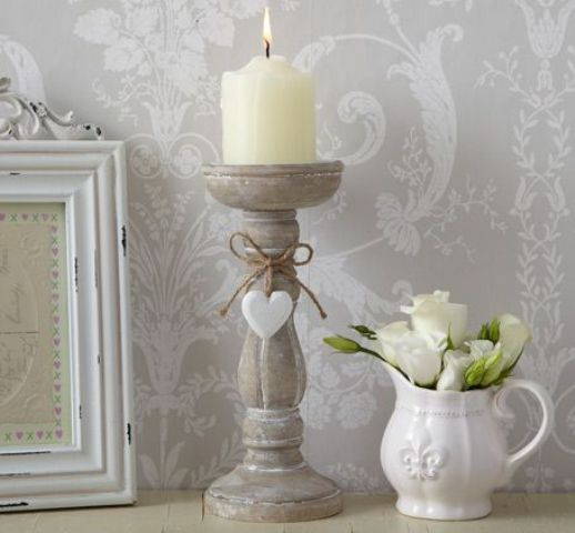 shabby candleholder and a milk jug used as a vase