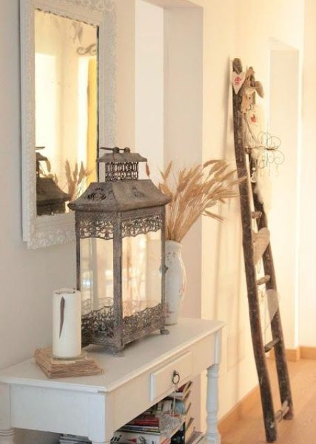 white entryway with wooden decor and a vintage metal lantern