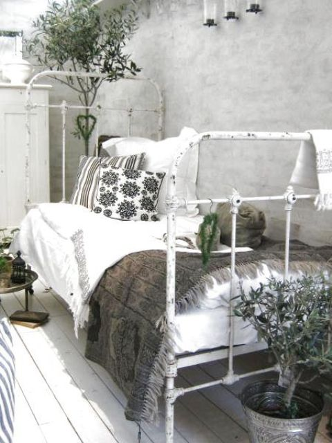 shabby whitewashed bed instead of a bench