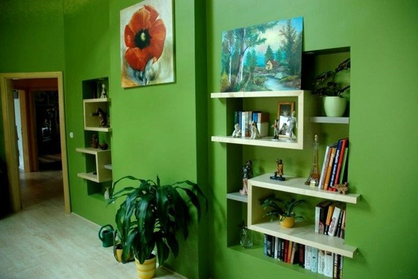 Living room with wall color green tones