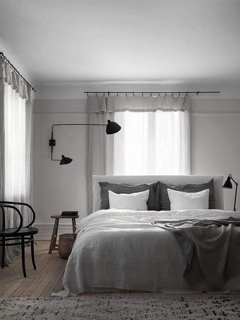 Cozy Scandinavian bedroom, linen bedding and linen curtains