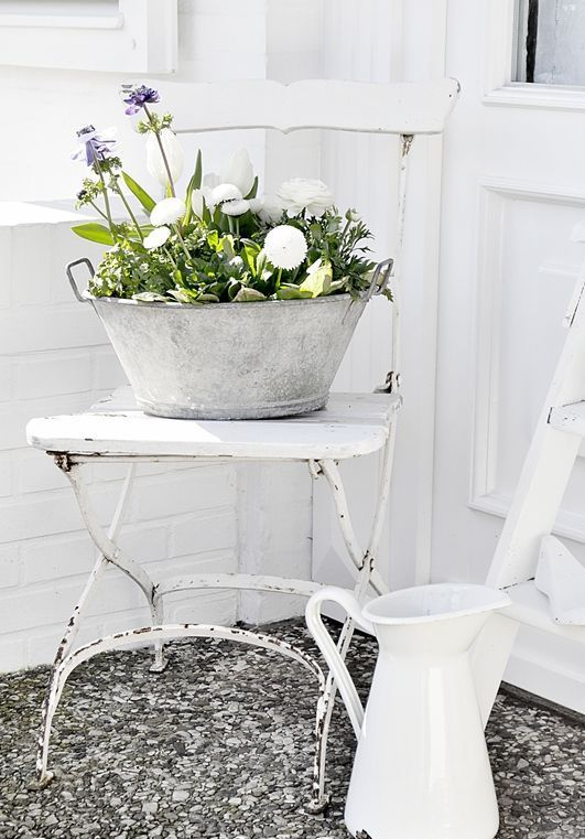 bucket with wildflowers and a whitewashed jug as a vase