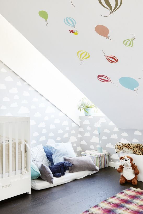 colorful attic kids' room with cute prints