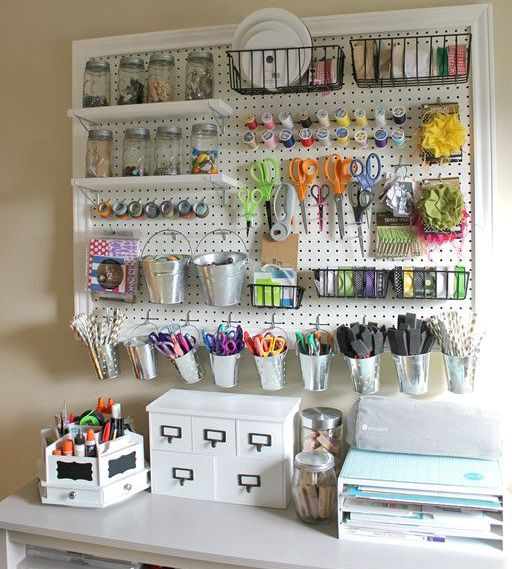 pegboard with shelves and buckets