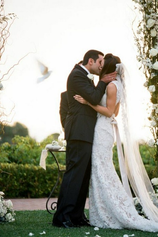 White wedding doves and a kiss