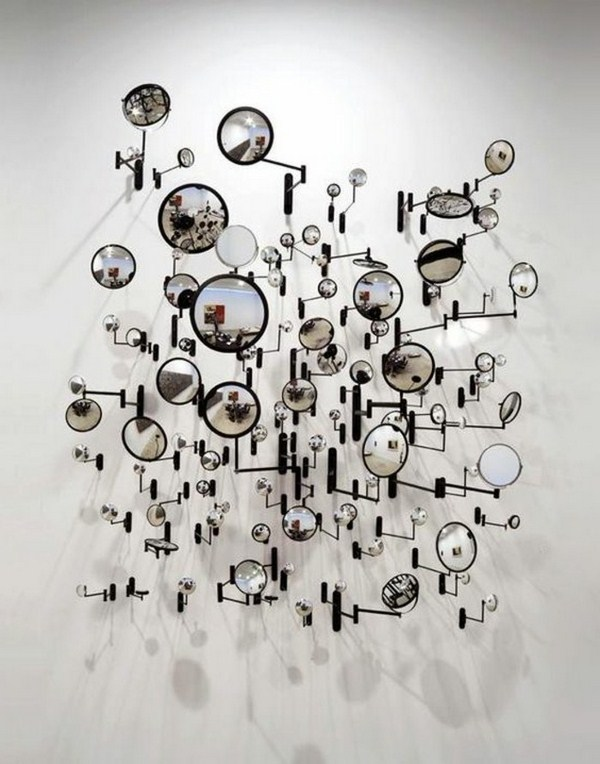 Contemporary art with round mirrors