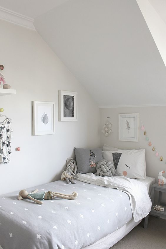 Scandinavian attic girl's room in grey and blush