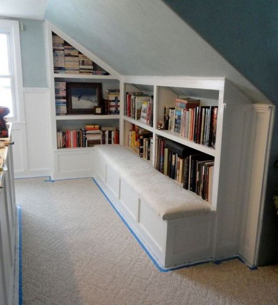 fitted attic bookshelves with seats