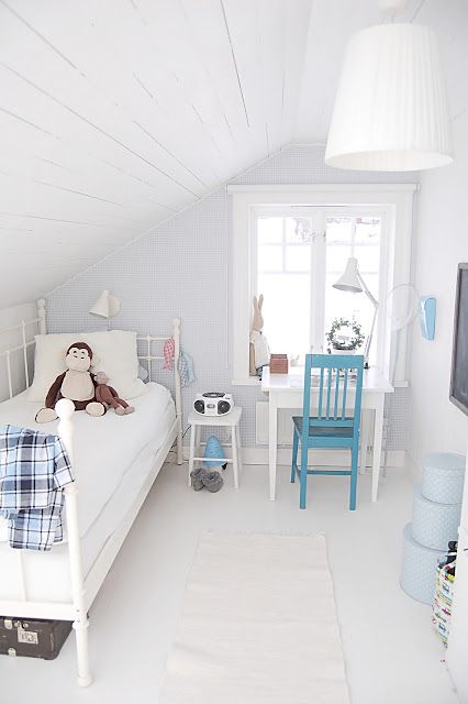 Scandinavian boy's room in the attic