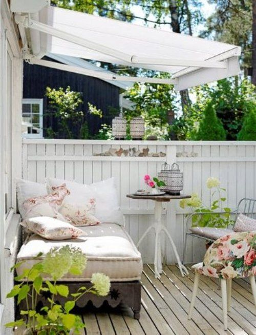 shabby chic deck with floral textiles