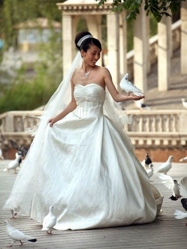 White wedding doves surrounded the bride