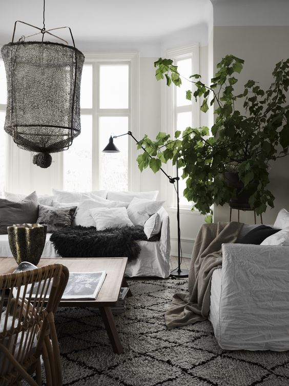 Cosy and relaxed Scandinavian living room with mix of textures and natural materials